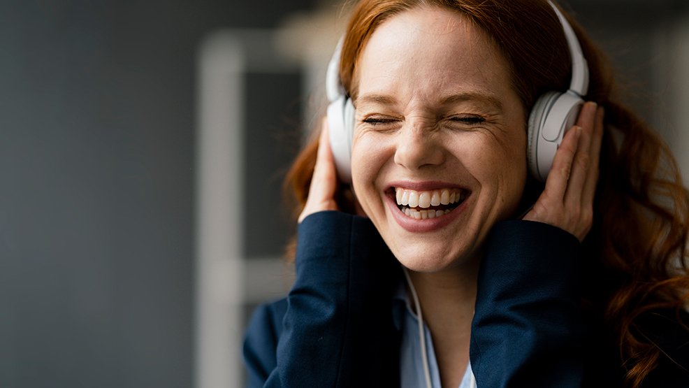 A woman with headphones on