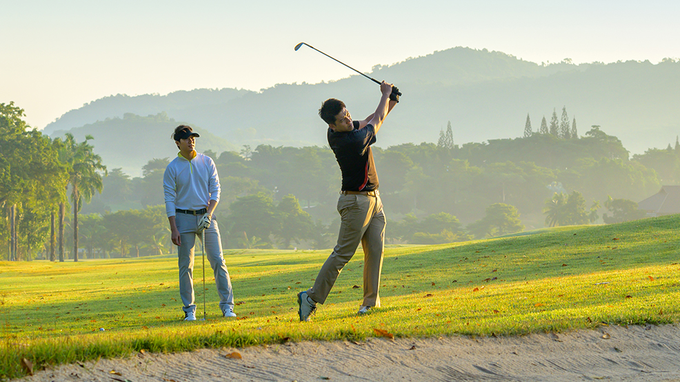 A couple playing golf
